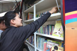 Explore Students engaging with Book Bus